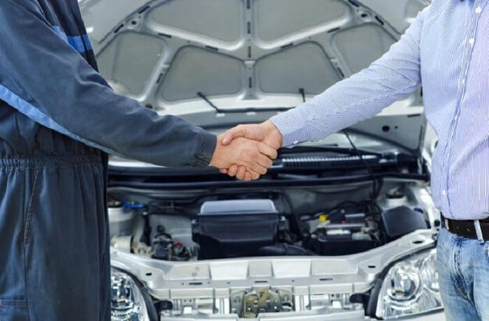 car-mechanic-customer-shaking-hands