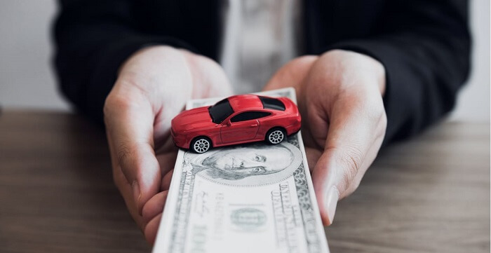 selling a car with a loan to a dealership
