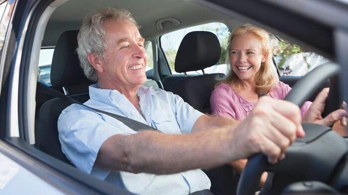 older_couple_car