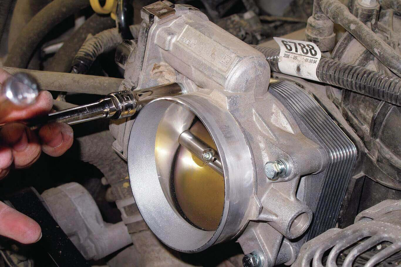 what does a throttle body spacer do