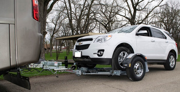 process of how to tow a non running car on a tow dolly